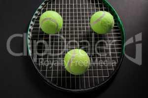 High angle view of balls on tennis racket