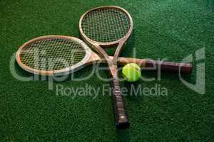 Close up of wooden rackets with tennis ball