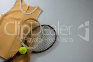 Directly above shot of rackets with vest and tennis ball