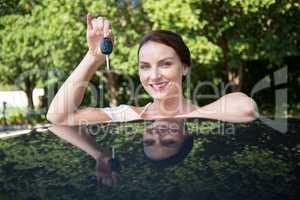Beautiful woman holding a car key