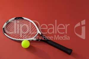 High angle view of tennis racket and fluorescent yellow ball