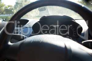 Car interior with steering wheel and dashboard