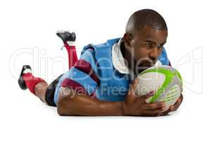 Male rugby player scoring a try