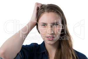 Confused teenage girl looking at camera