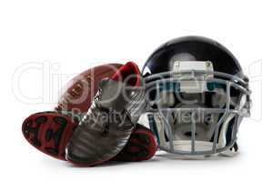Close up of sports shoes with helmet and American football