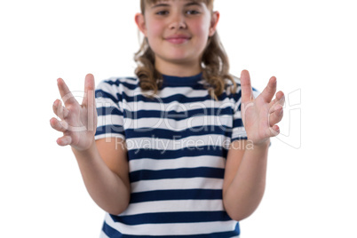 Portrait of girl pretending to be holding invisible object