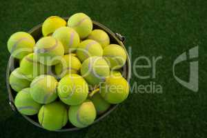 High angle view of tennis balls in bucket