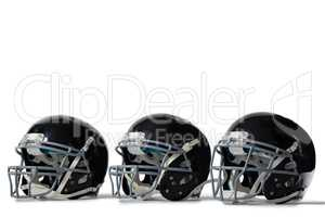 Close up of black sports helmets arranged side by side