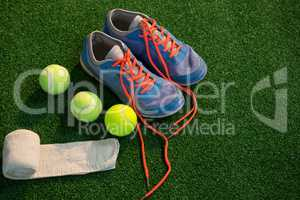 Sports shoes with tennis ball and napkin