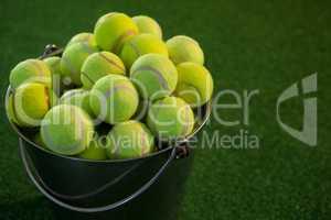 Tennis balls in bucket
