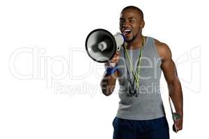 Male rugby instructor announcing on megaphone