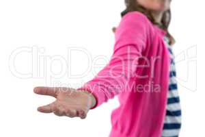 Mid section of girl pretending to be holding invisible object