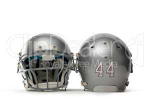 Close up of silver colored sports helmets