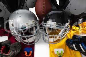 High angle view of chest protector with American ball and sports gears