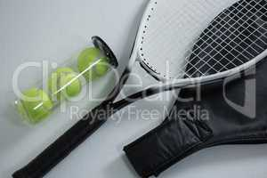 High angle view of tennis racket by balls in container