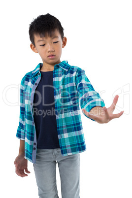 Boy pretending to hold invisible object