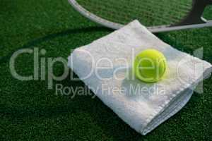 Tennis ball on napkin by racket
