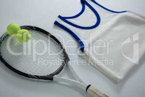 High angle view of racket with tennis balls by vest