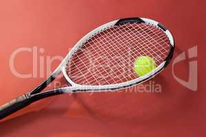 High angle view of fluorescent yellow ball with tennis racket