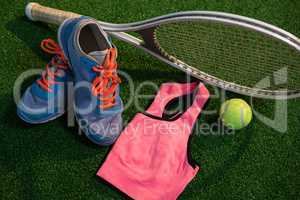 Sports shoes with tennis ball and racket by sports bra