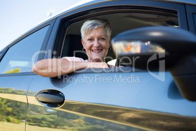 Active senior woman driving a car