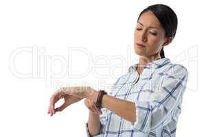 Female executive looking at her wristwatch