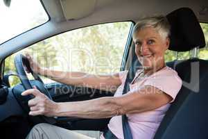 Active senior woman driving a car