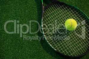 High angle view of tennis ball on racket