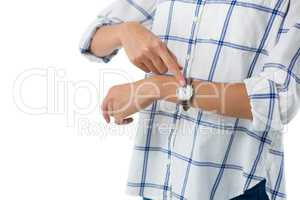 Female executive pointing at the wristwatch
