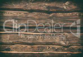 Empty brown wooden background of parallel boards