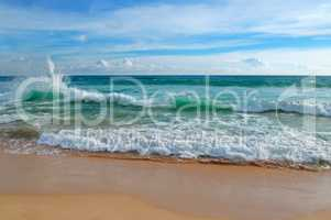 ocean, sandy beach and blue sky