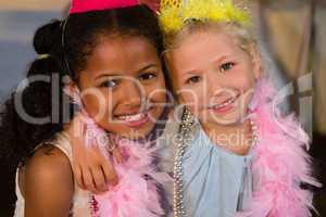 Portrait of girls wearing feather boa