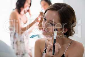 Bride applying her makeup doing her wedding preparation