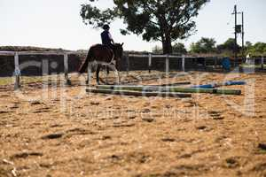 Boy riding a horse in the ranch
