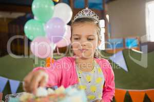 Birthday girl eating cake