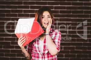 Surprise woman holding envelope