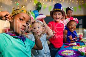 Playful kids at table