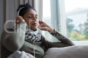 Relaxed woman listening to music