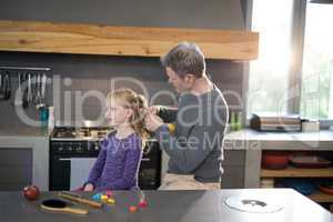 Father styling daughters hair