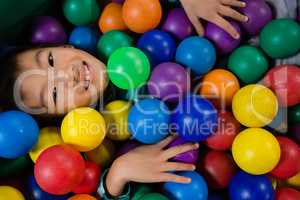 Directly above portrait of boy in ball pool