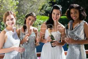 Bride and bridesmaids having champagne