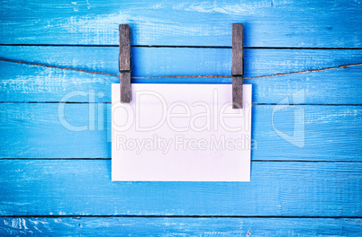 White paper envelope hanging on a rope