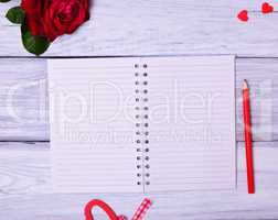Blank open notebook in a line