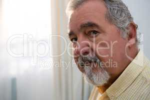 Portrait of serious senior man in retirement home