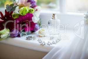 Bouquet of flower kept on window sill