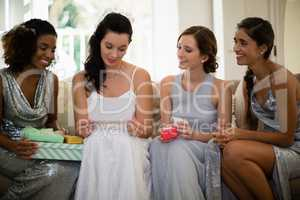 Bride receiving gifts from bridesmaids