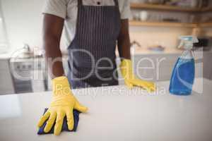 Man cleaning the kitchen worktop