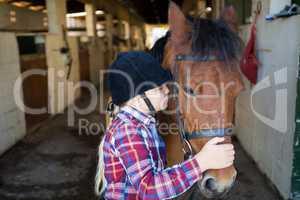Girl kissing the horse
