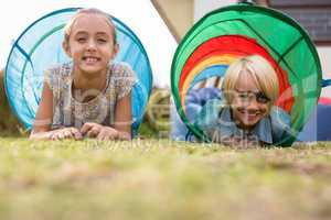 Portrait of children in tent tunnel