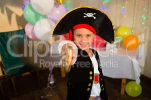 Boy pretending to be as pirate during birthday party